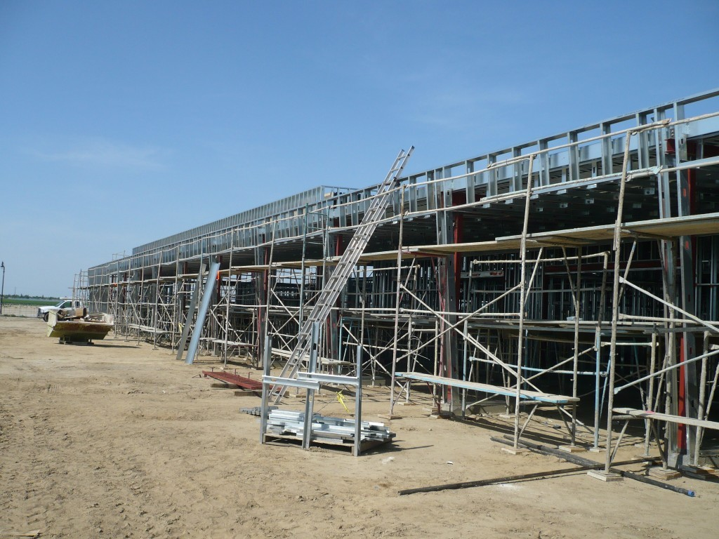 The exterior studs were attached to the structural steel with 12″ Dietrich extended deflection clips with Tec 5 SMS