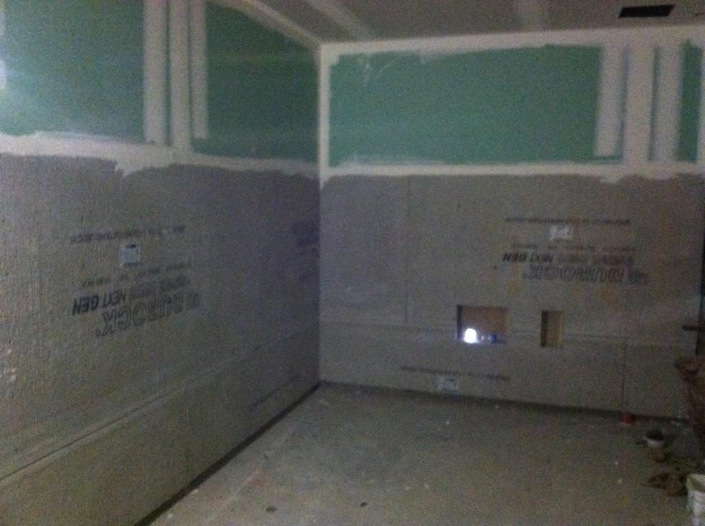 We installed tile backer board under the ceramic tile in the restrooms