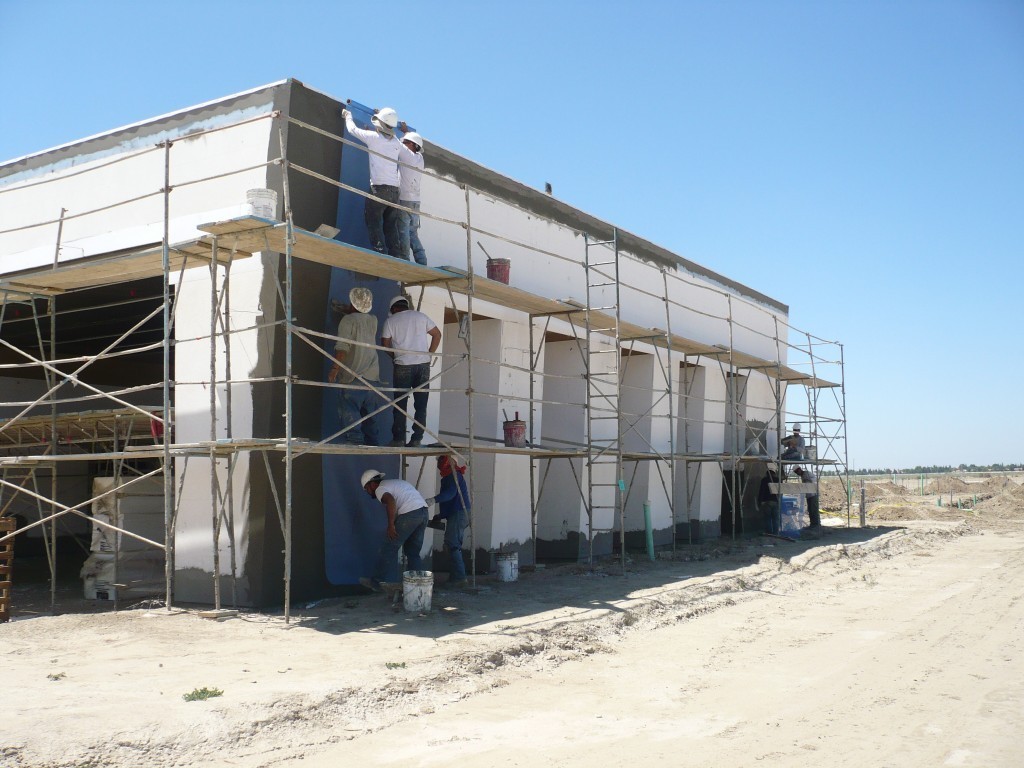 Sweaney applied a Dryvit standard PB EIFS system with a Sandblast finish over 900 sheets of 5/8″ Dens-glass sheathing.